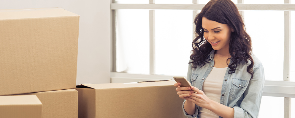 Woman in front of moving boxes